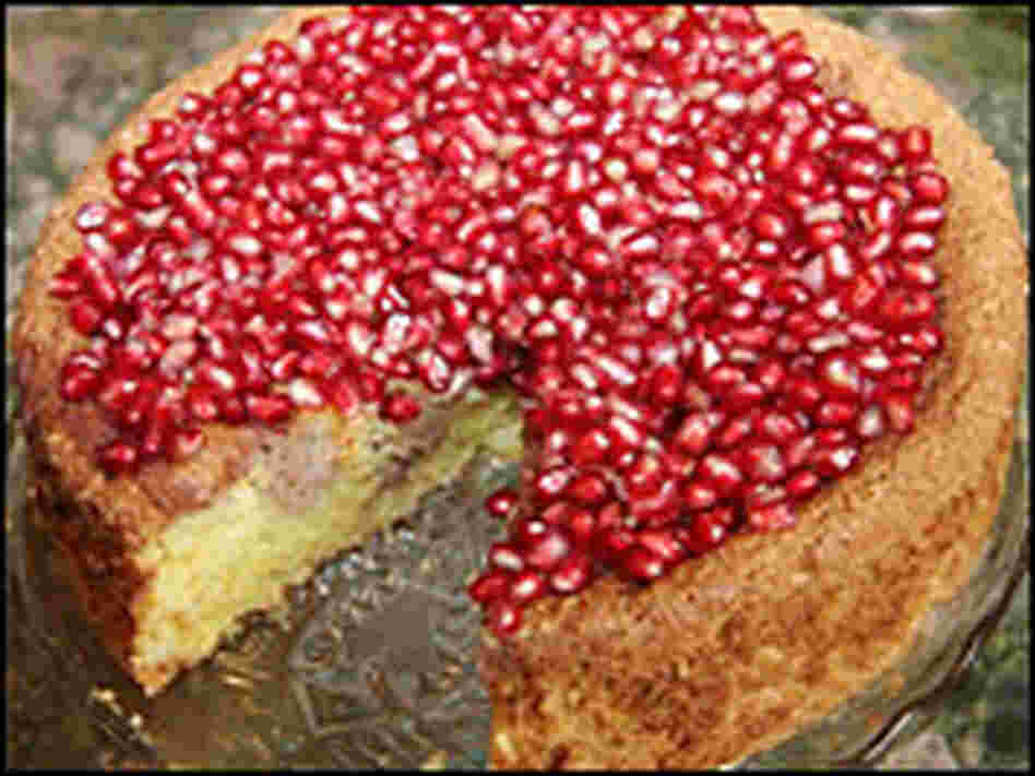 "Nigella Lawson calls this pomegranate confection ""an open jewel-case of a cake."""