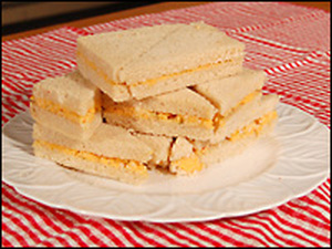 Pimento cheese on white bread with the crusts cut off has been a staple of Southern tables for generations. It's simple, inexpensive and delicious.