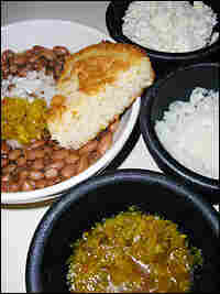 Cornbread and beans, onions, cole slaw and chow chow relish