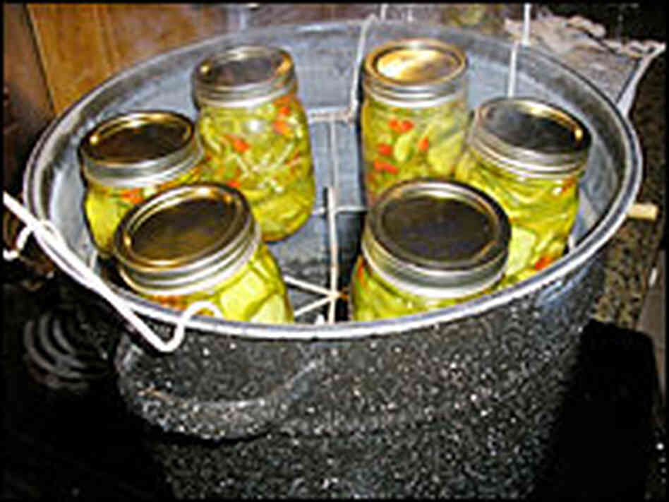 Higher acid foods (such as pickles, relishes and jams) are commonly processed in a water canner.