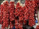 "Dried red chiles — strung into ""ristras"" — hang in many New Mexican homes."