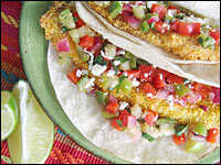 Crispy baked fish tacos with green tomato salsa