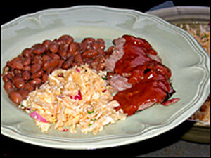 A Texas-inspired meal features slow-cooked beef brisket, beans and coleslaw.