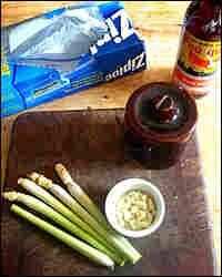 Ingredients for a marinade: lemongrass, garlic, fish sauce, sugar and a zip-top freezer bag