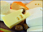 A platter of different cheeses and olives