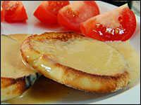 Welsh Rarebit (Rabbit): Cheese sauce on a split, toasted English muffin