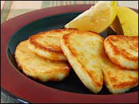 Slices of saganaki with a bit of lemon