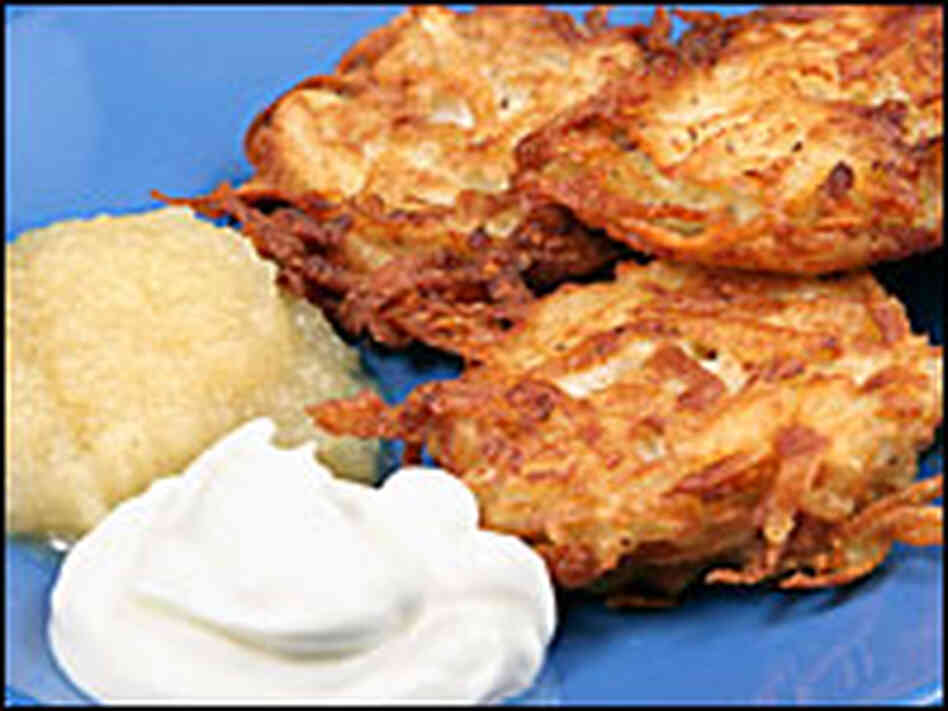 Potato latkes with sour cream and applesauce