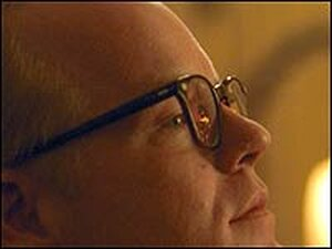 Philip Seymour Hoffman holds a drink as 'Capote.'