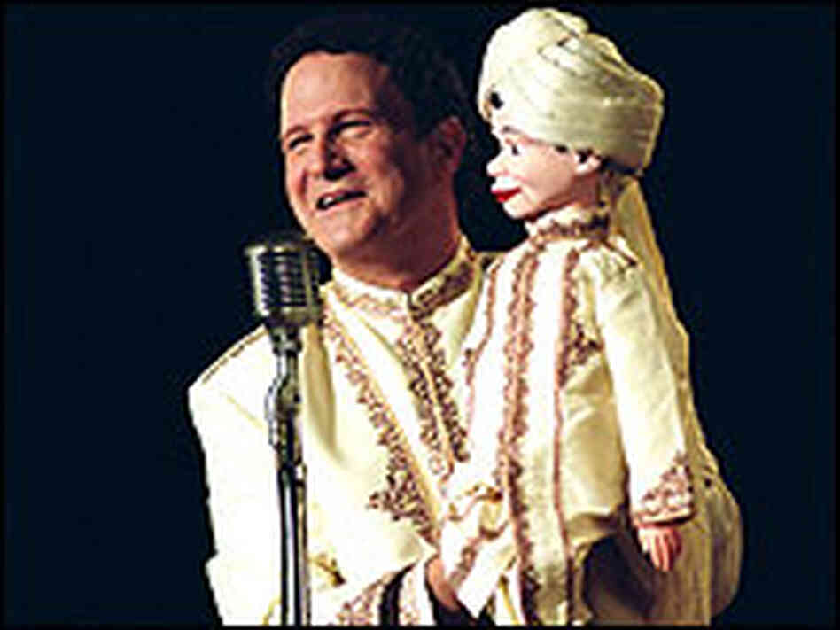 Albert Brooks with a ventriloquist's dummy in a scene from his latest film.