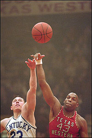 Two players leap for a basketball in a scene from 'Glory Road.'