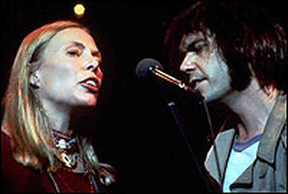 Joni Mitchell and Neil Young, singing together in 1978 in scene from The Last Waltz.