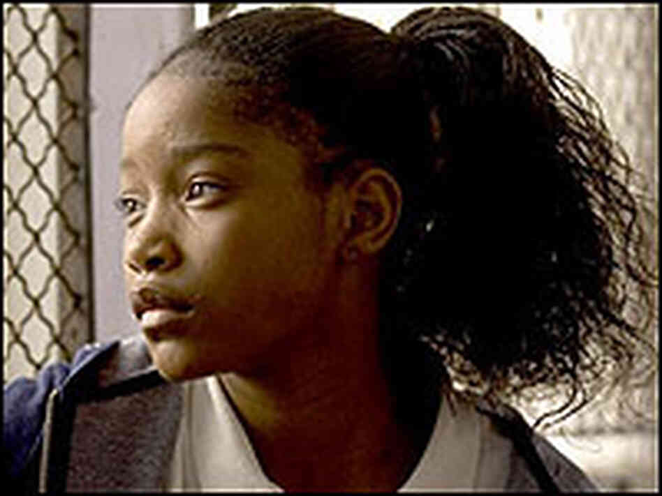 Keke Palmer gazes out a window with bars on it in a scene from the movie 'Akeelah and the Bee'