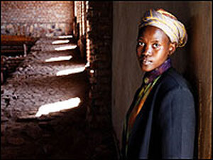 Mary, a Rwandan woman featured in the documentary, inside a church with light and shadow.