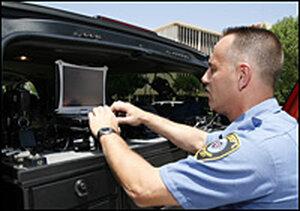 Oklahoma City Fire Department Capt. Jim Kruta accesses the city's Wi-Fi mesh network
