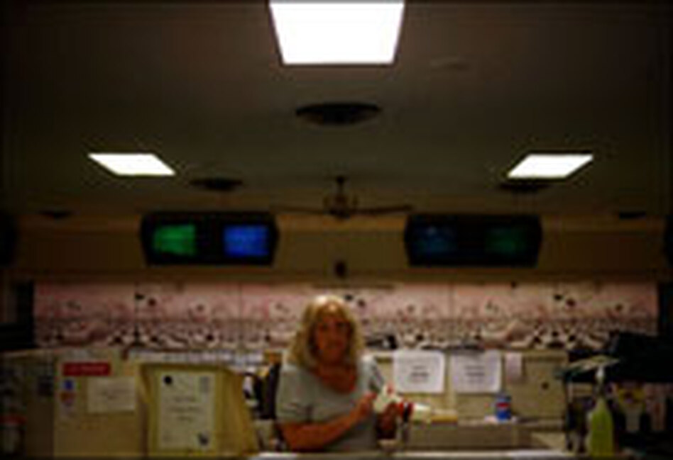 Judy Baisden works the counter of Plaza Lanes Bowling Alley. Like many voters in West Virginia, she is undecided about whom to vote for.