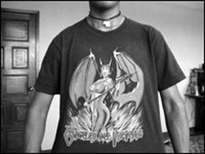 A 20-year-old former gang member, El Cholo, shows satanic imagery on his T-shirt.