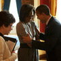 "President Obama and first lady Michelle Obama share a moment in the Red Room of the White House along with adviser Valerie Jarrett and other staffers. ""They had just a second together to say hi,"" says Shell, ""and they have an amazing ability to tune the world out for just two seconds."""