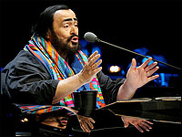Pavarotti in concert on his farewell tour in Beijing in 2005. (Getty Images)