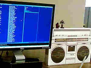 a boom box by a computer
