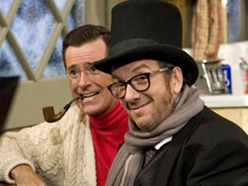 300 Stephen Colbert (left) and Elvis Costello