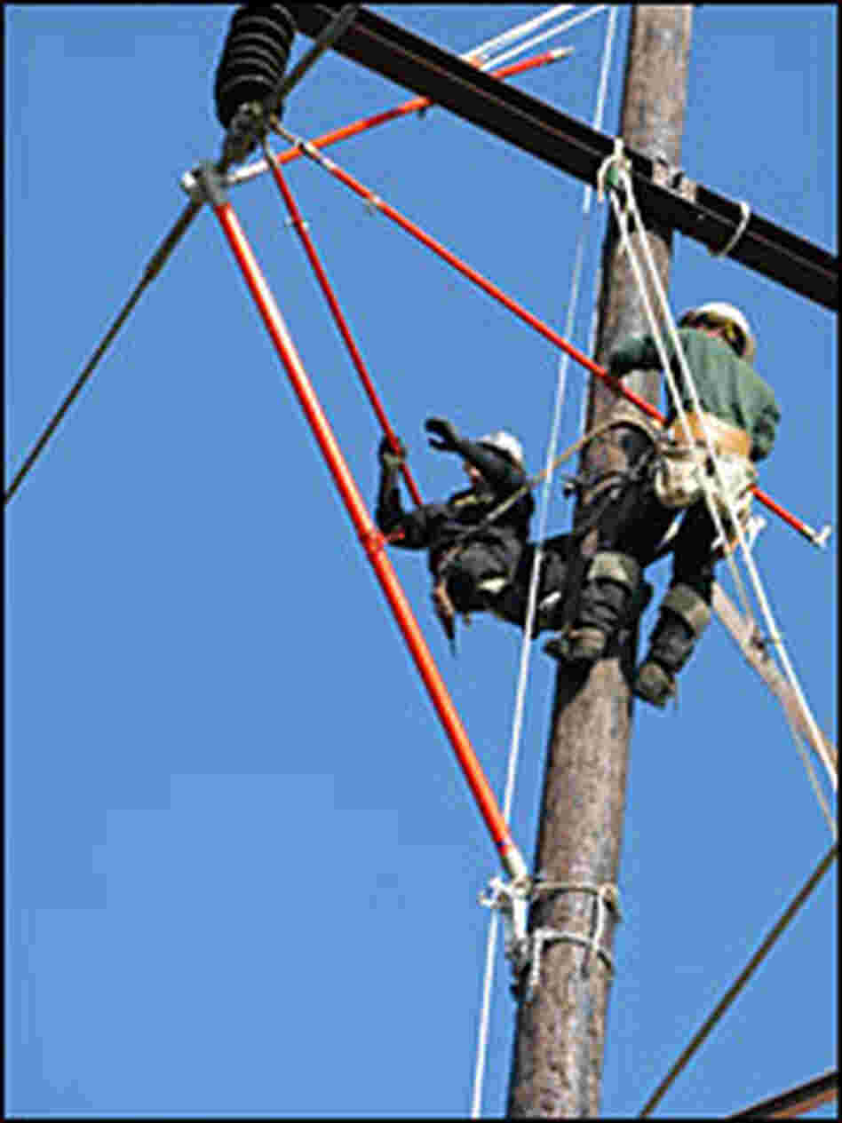 Electrical apprentices practice replacing a glass insulator