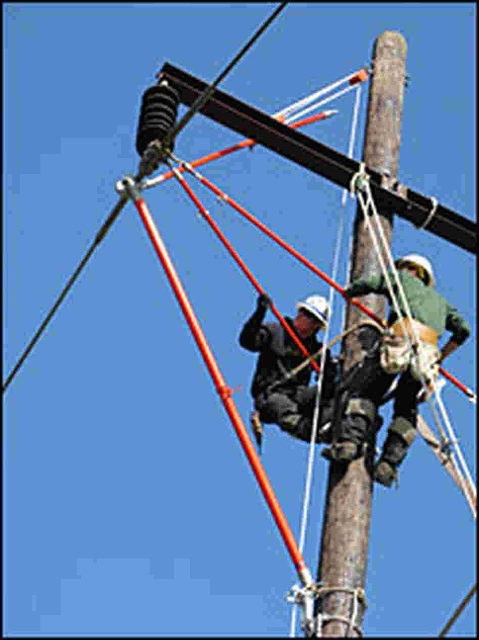 Workers practice repairing power lines.