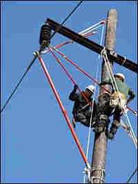 Workers practice repairing power lines.