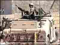 A video image shows U.S.-led forces on patrol in Najaf, Aug. 12, 2004.