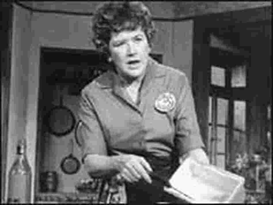 Julia Child shown cooking on television in 1971.