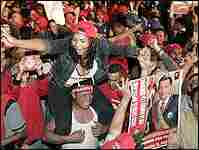 Supporters of Venezuelan President Hugo Chavez celebrate.