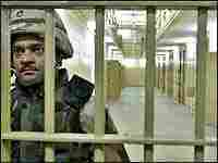 A U.S. soldier guards cells inside the Abu Ghraib prison, May 2004.