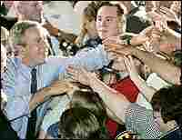 President George W. Bush shakes hands at a campaign event in Michigan
