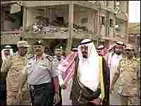 Saudi Crown Prince Abdullah surveys the damage from a May 2003 suicide bombing in Riyadh.