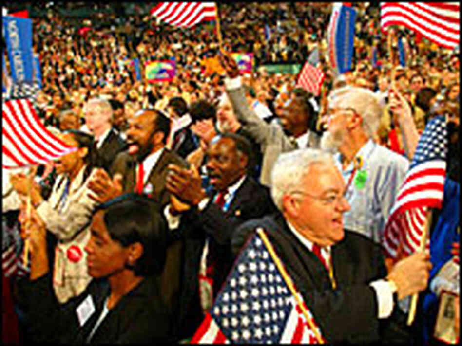 Delegates react to a speech by former presidential candidate Rev.Al Sharpton. Credit: Reuters