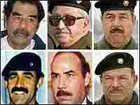 File photo of Saddam Hussein with six of the 11 senior officials of his deposed regime.