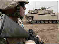 Lance Cpl. Rick J. Meyers, 21, a rifleman, prepares to move his fire team in Fallujah's Camp.
