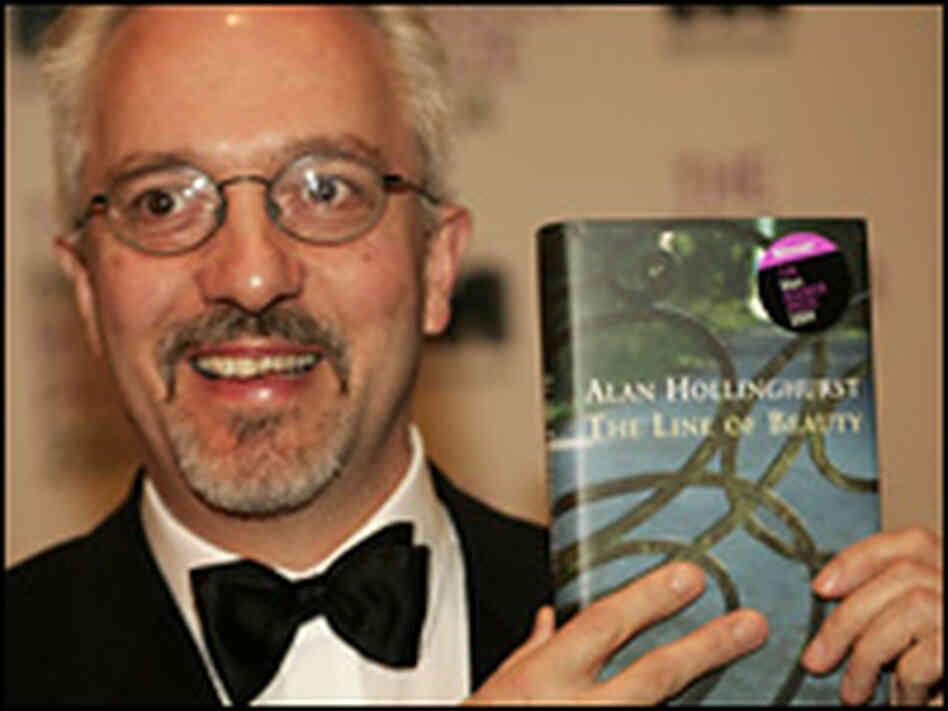 Alan Hollinghurst holds his winning novel, 'The Line of Beauty,' Oct. 19, 2004.