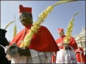 Cardinals Francis Arinze, left, and Angelo Sodano celebrate Palm Sunday mass.