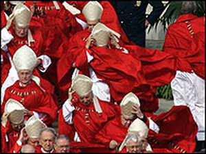 Cardinals hold on to clothing as winds whip St. Peter's Square