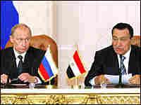Russian President Vladimir Putin, left, and his Egyptian counterpart Hosni Mubarak.