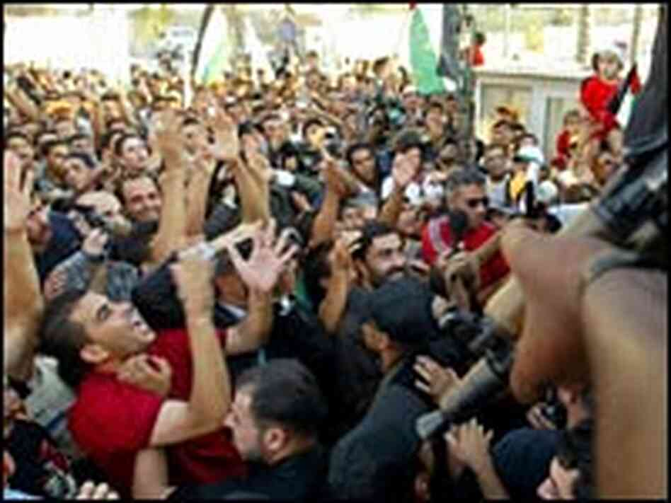 Palestinians celebrate Israel's imminent pullout from the Gaza Strip.