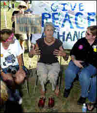 Folk music legend Joan Baez, center, talks to military mothers near President Bush's ranch.