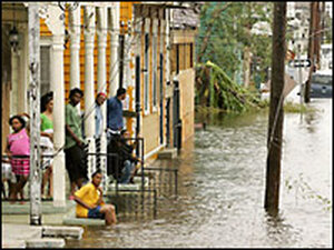 A family waits for the water to recede in New Orleans.