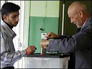 A man votes at a polling station in Baghdad, Dec. 15.