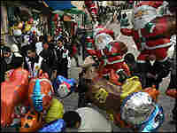 Palestinian street vendors sells balloons for Christmas near the Nativity Church.
