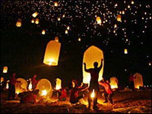 Thousands of floating paper lanterns fill the sky over the Andaman Sea in remembrance of tsunami vi