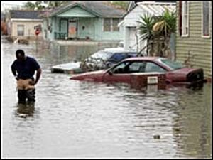 A man wades in the floodwaters of New Orleans' Lower Ninth Ward, Sept. 14, 2005.