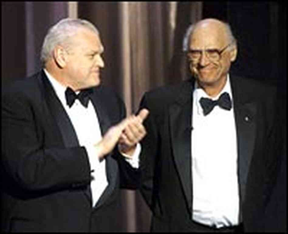 Arthur Miller, right, is applauded by actor Brian Dennehy.