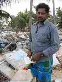 John Bosco amid rubble in Sri Lanka village.